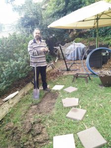 Chris laying paving slabs for fire area